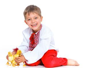 Boy with cute ducklings