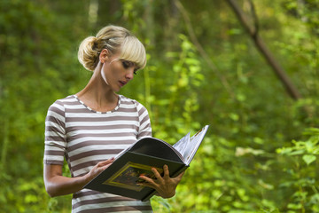 Young woman reads the book on vacation