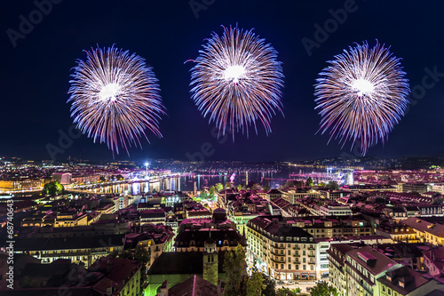 Papiers peints Europe Centrale Panoramic view of the city of Geneva at night,, fireworks for th