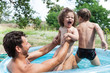 Father with children in pool