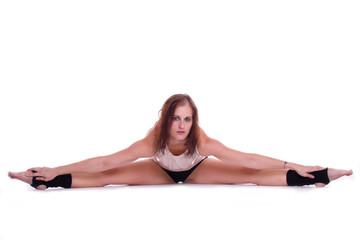 Spagat - Tänzerin dehnt ihre Beine