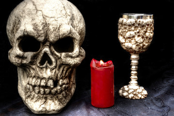 skull with candle and goblet