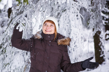 Outdoors portrait of young beautiful woman having fun in winter