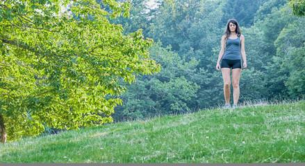 Female athleteand runner running on park