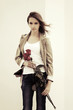 Sad young fashion woman with a roses