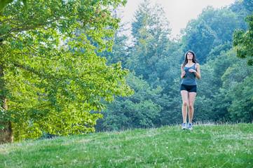 Female athlete and runner running on park