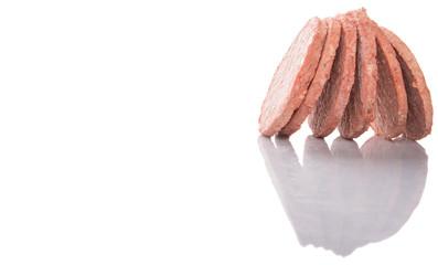Frozen raw hamburger beef meat over white background
