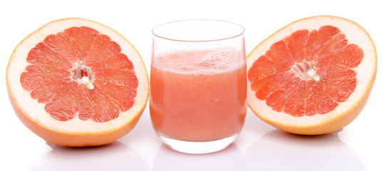Glass of grapefruit juice with fresh grapefruit