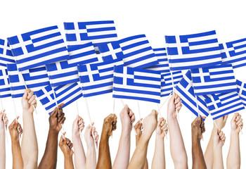 Group of Hands Holding Greek Flag