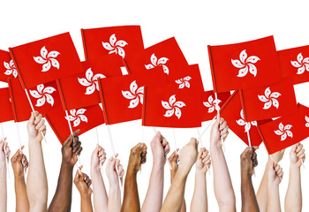 Group of Hands Holding Flag of Hong Kong