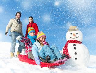 Family Enjoying The Winter Day