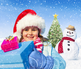 Little Girl Holding Gifts And A Snowman