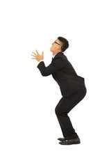 young business man standing a funny pose with white background