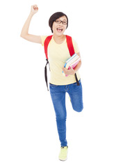 happy young student girl raising a hand with book