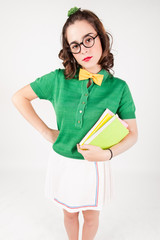 Nerdy girl holding books looking at camera.