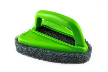Green sponge brush on white background
