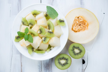 Melon and kiwi fruit salad, above view, horizontal shot