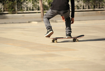 young boy skateboarding in the city