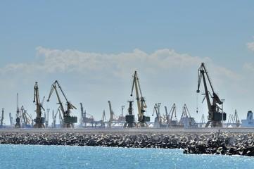 Port cargo crane and concrete block breakwater