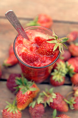 Strawberry smoothie in glass, toned