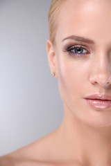 Cropped image of young female face with healthy skin isolated on