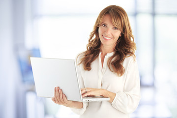 Modern attractive business woman with laptop