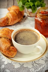 Poppy seed croissant with a cup of coffee