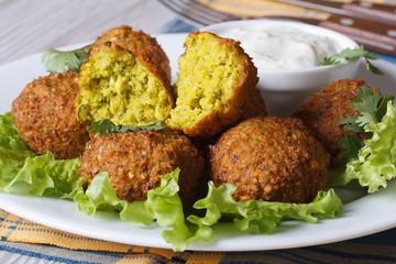 Falafel on the lettuce with tzatziki sauce, horizontal