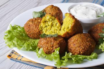 falafel with lettuce and tzatziki sauce closeup horizontal