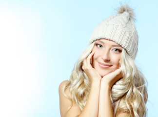 christmas girl, young beautiful smiling girl over blue backgroun