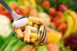 spoon with dietary supplements on fruits background - 68751665