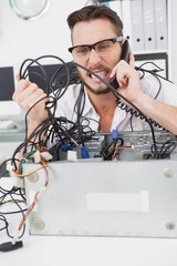 Angry computer engineer making a call