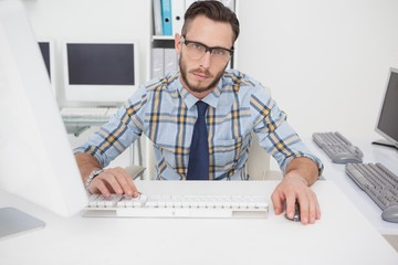 Bored casual businessman working at his desk