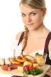 Frau im DIrndl mit typischen Essen