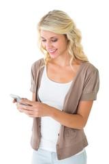 Attractive blonde using her smartphone
