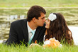 wedding, beautiful young bride lying together with groom in love
