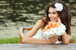 young woman with flowers summer outdoor, beautiful bride has fun