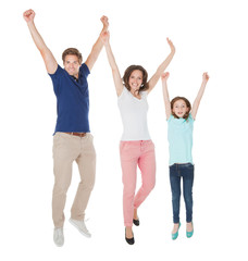 Portrait Of Excited Family Jumping