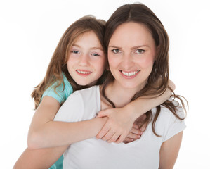 Happy Mother Piggybacking Daughter