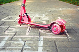 background of playground with pink little kid scooter and hopsco