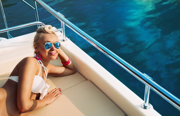 young fashion woman relaxing on yacht