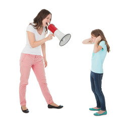 Angry Mother Shouting Through Megaphone At Daughter