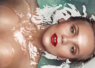 portrait of a beautiful sensual glamourous blonde in water, vogu