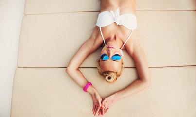 young fashion hot body woman relaxing on yacht