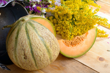melon with a bouquet of yellow flowers