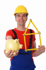 worker with yardstick- house and piggy bank