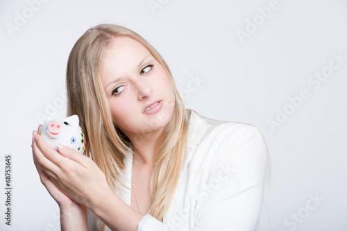 canvas print picture Mädchen mit Sparschwein