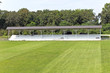 Wooden grandstand with roof and football field
