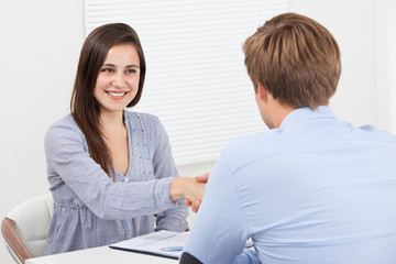 Candidate Shaking Hand With Businessman
