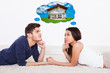 Couple Thinking Of Dream House